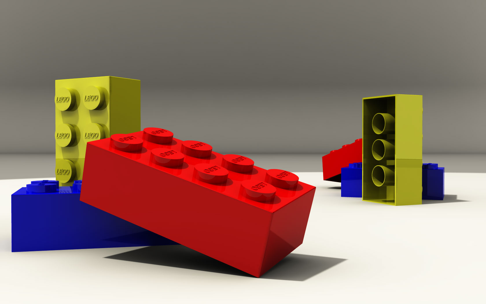 3D rendering of a blue, red and yellow unconnected Lego brick posed for a stylish semi-realistic image