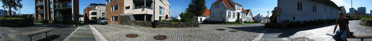 360 degrees photo of the city edge of old Stavanger, Aleksander is sitting on the bench.
